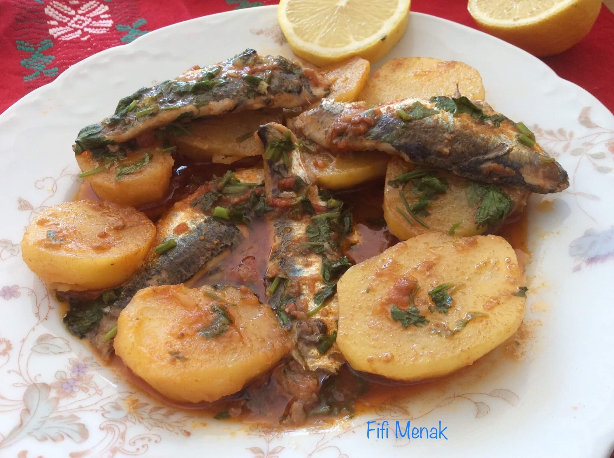 Sardines et pommes de terre en sauce à l' ail et au cumin